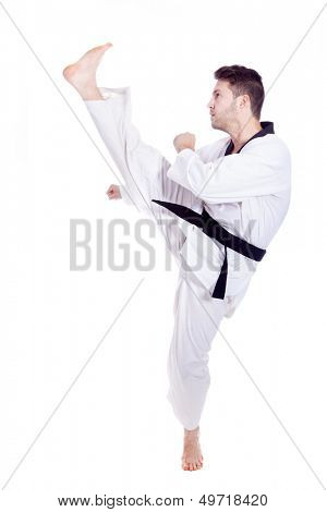 Young man in kimono training martial arts, isolated over white background