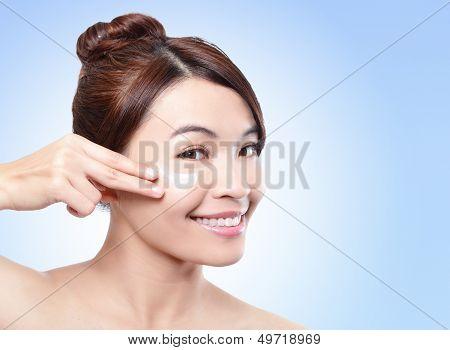 Beautiful Face Of Girl Applying Moisturize Cream