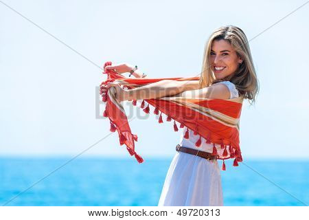 Cute Blond Playing With Red Scarf Outdoors.