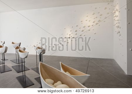 Glazed ceramics boats in art gallery