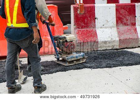 Workers Are Repairing A Road In Bangkok