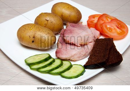 Grilled Pork With  Boled Potato, Vegetables And Bread