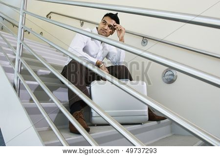 Businessman Sitting on a Stairway