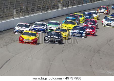 BROOKLYN, MI - AUG 18, 2013:  The NASCAR Sprint Cup teams take to the track for the Pure Michigan 400 race at the Michigan International Speedway in Brooklyn,  MI on Aug 18, 2013.