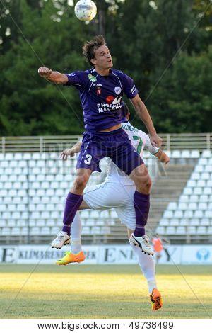 KAPOSVAR, HUNGARY - AUGUST 3: Jozsef Mogyorosi (in pruple) in action at a Hungarian National Championship soccer game - Kaposvar (white) vs Kecskemet (purple) on August 3, 2013 in Kaposvar, Hungary.