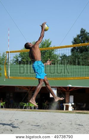 KAPOSVAR, HUNGARY - AUGUST 4: Leonel Munder in action at a ROAK Viragfurdo Kupa beach volleyball competition, August 4, 2013 in Kaposvar, Hungary.