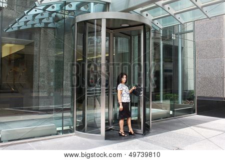 Woman by the door of the hotel, welcoming people in