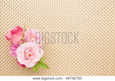 Artificial Rose On The Table Cloth