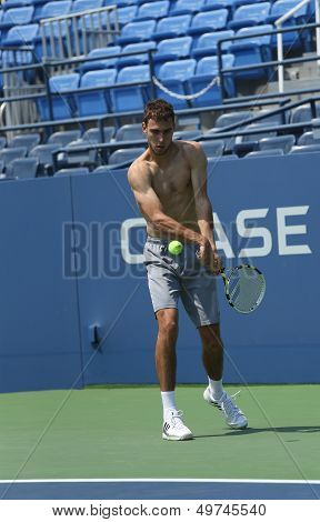 Professional tennis player Jerzy Janowicz practices for US Open 2013 at Louis Armstrong Stadium