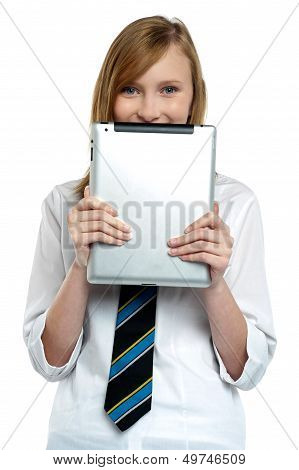 Shy Girl Hiding Her Face With A Tablet Device