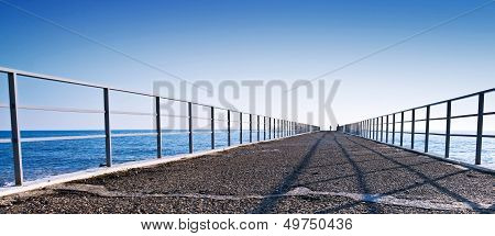 Pier Perspective On Black Sea Coast. Russia, Sochi, Adler.