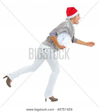 Shocked Young Woman In Sweater And Christmas Hat Running With Cl