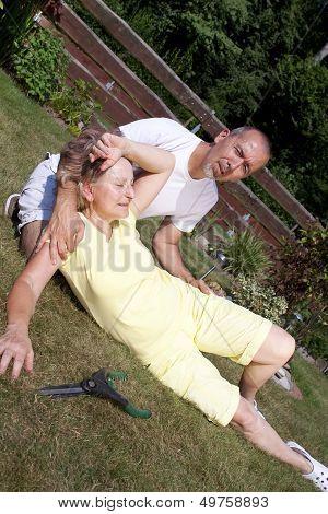 Man Helping Woman With Heatstroke