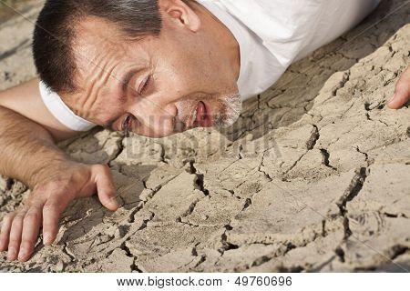 Thirsty Man In A Desert