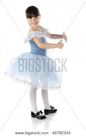 A beautiful elementary tap dancer smiling at the viewer as she poses in a dance form.  On a white background.