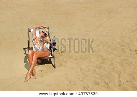 Beautiful blonde woman in bikini on the beach