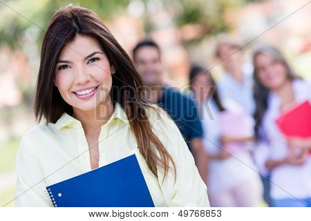 Beautiful portrait of a college student looking happy outdoors