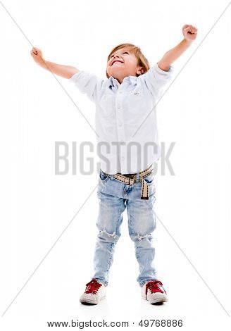 Happy boy with arms up celebrating - isolated over a white background