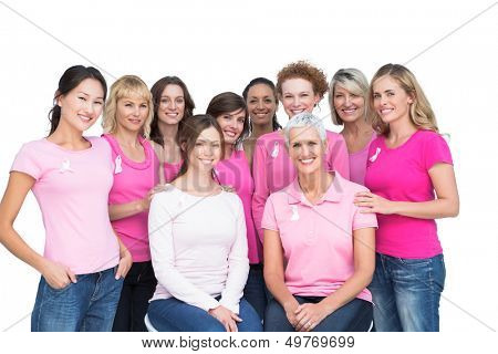 Cheerful pretty women posing and wearing pink for breast cancer on white background
