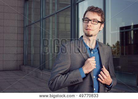 Attractive Young Businessman Looking Satisfied