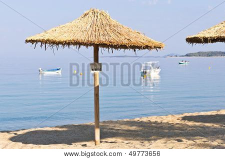 Thatched sunshade on a beach reserved for you