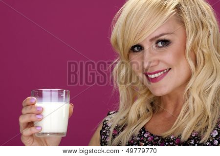 Woman drinking milk.