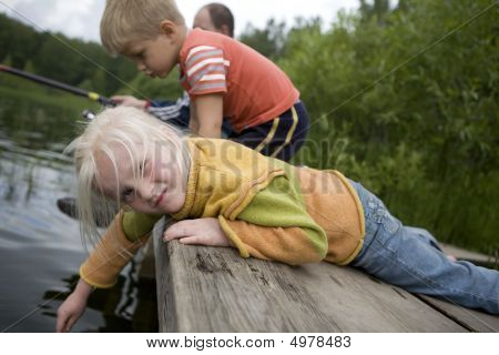 Little Blond Cute Girl Playing In Water