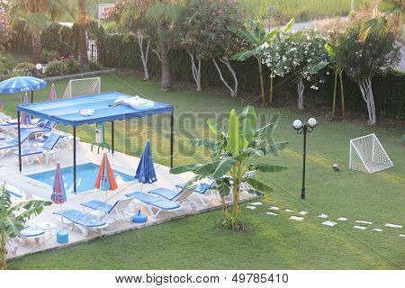 A movable sun shade above a childrens swimming pool