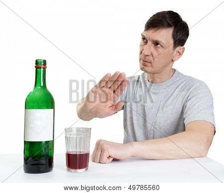 drinking wine ,man shows gesture of refusal