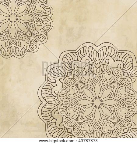 Vintage background with mandala ornament on grunge paper