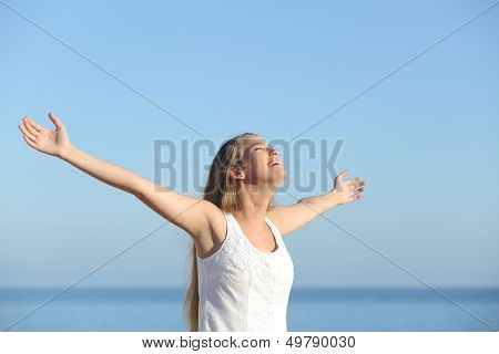 Beautiful Blonde Woman Breathing Happy With Raised Arms
