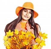 pic of overcoats  - Woman wearing overcoat holding  orange leaves - JPG