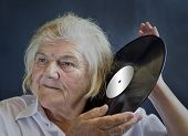 stock photo of lps  - An elderly woman listening LPs - JPG