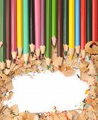 Colorful pencil border colorful pencil shavings on white background
