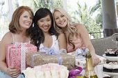 stock photo of bridal shower  - Portrait of multiethnic women with presents at wedding shower - JPG