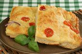 picture of flat-bread  - Tomato and red onion focaccia bread pieces - JPG