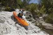 stock photo of kayak  - Man kayaking on mountain river - JPG