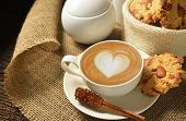 picture of latte  - A cup of cafe latte and cookies - JPG
