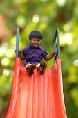 Beautiful & Happy Indian Girl(kid) On Park Slider On A Summer Day