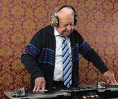 image of grandpa  - a very funky elderly grandpa dj mixing records - JPG