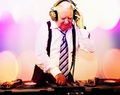 image of grandpa  - a very funky elderly grandpa dj mixing records - JPG