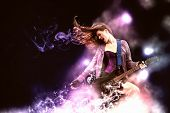 stock photo of guitar  - Young attractive rock girl playing the electric guitar - JPG
