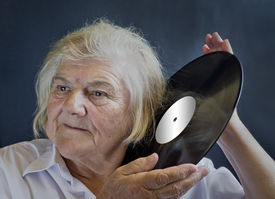 picture of lps  - An elderly woman listening LPs - JPG