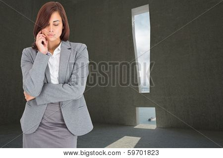 Thinking businesswoman against exclamation mark door in dark room