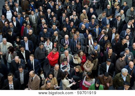 VALENCIA, SPAIN - FEBRUARY 12, 2014: A crowd of business people waiting to enter the 2014 Feria Habitat Valencia Trade Fair in Valencia.