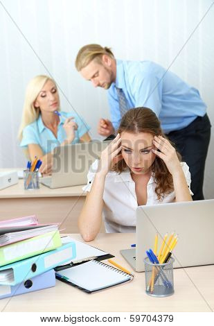 Office staff is during work in workplace