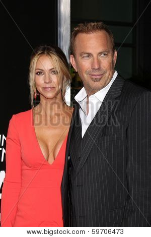 LOS ANGELES - FEB 12:  Christine Baumgartner, Kevin Costner at the