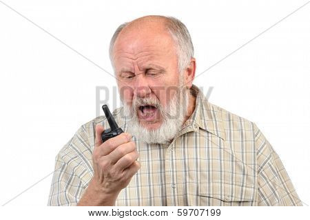 angry senior bald man screaming to walkie-talkie