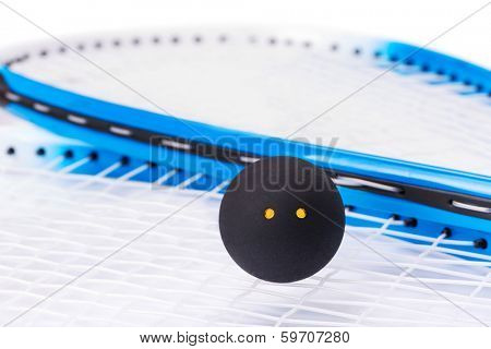 Close up of a squash rackets and ball
