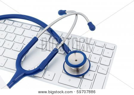 stethoscope and keyboard of a computer, symbol photo for diagnosis and appointment management